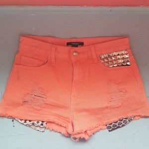 Orange high waisted cut off shorts